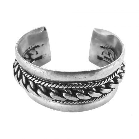 Bracciale a manetta in argento con motivo a treccia