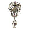 Spilla antica in oro e argento con diamanti, rubini e smalto